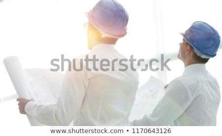 Stock fotó: üzletember · gondolkodik · építészeti · tervek · fehér · iroda