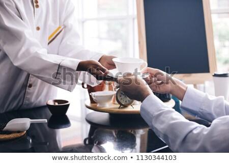 Férfi kávé pincérnő boldog üzletember mosolyog Stock fotó © Kzenon