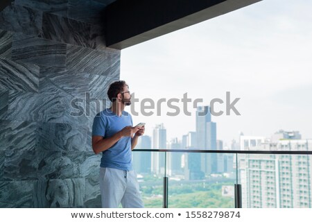 画像 小さな ビジネスマン タッチパッド オフィス 午前 ストックフォト © Freedomz