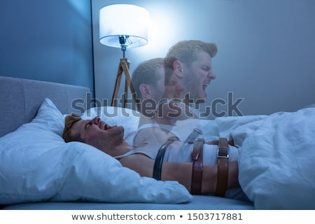 man suffering from sleep paralysis stock photo © andreypopov