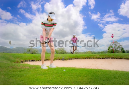 Golfer pitching over obstacle Stock photo © lichtmeister