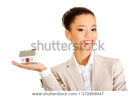 Woman Holding Model House In Palm Of Hand Stock photo © HighwayStarz