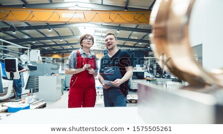 Workers on the factory floor discussing the next project Stock photo © Kzenon