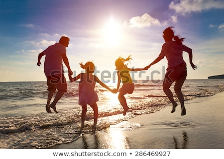 sziluett · család · tenger · tájkép · égbolt · víz - stock fotó © Harveysart