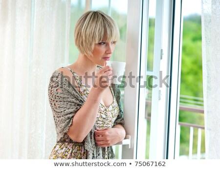 женщину утра кофе глядя балкона домой Сток-фото © dacasdo