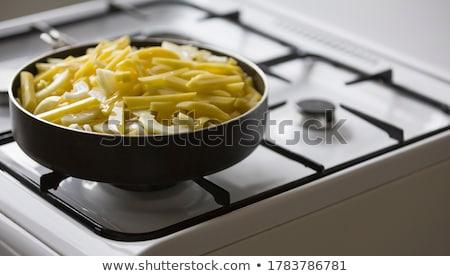 Fried potatoes in pan Stock photo © RuslanOmega