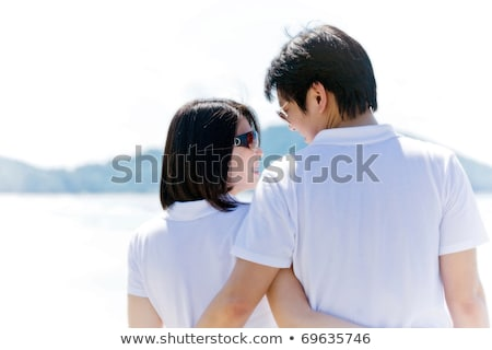 Closeup Of Romantic Couples Each Other Seeing Eyes On The Beach Stok fotoğraf © vichie81