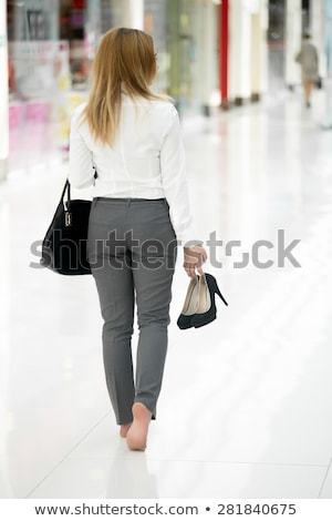 Woman carrying her shoes Stock photo © photography33