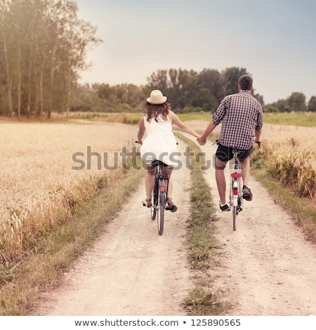 young couple outdoors with bicycles stock photo © photography33