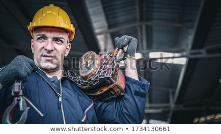 Stock photo: Man burdened by his tools