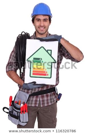 Villanyszerelő energia kártya nő ház építkezés Stock fotó © photography33