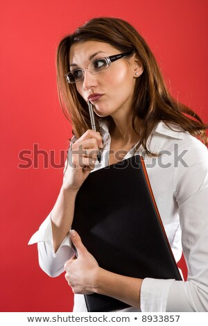woman holding folders and chewing on pen stock photo © photography33