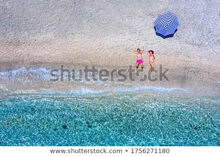 paar · strand · vrouw · bikini · zonnebaden · zee - stockfoto © CandyboxPhoto