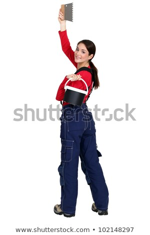 Woman with a bucket of tile adhesive and comb Stock photo © photography33