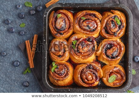 Berries And Cinnamon Rolls Stock photo © bendicks