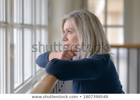 natural beauty portrait woman she looks in the hands stock photo © carlodapino