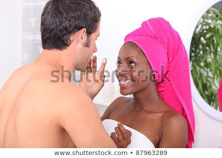 Man and woman messing around with moisturizer in the bathroom Stock photo © photography33