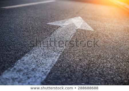 Stock photo: White arrow on the road