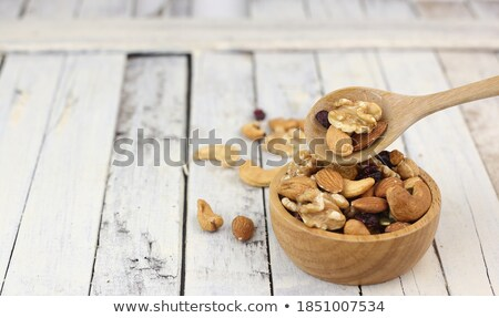 Wooden spoon with cashew nuts against a white background Stock photo © wavebreak_media