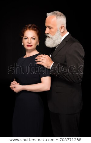 Woman with tied hair while touching her shoulder Stock photo © wavebreak_media