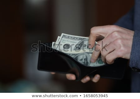 businessman hands counting money in his wallet isolated stock photo © len44ik