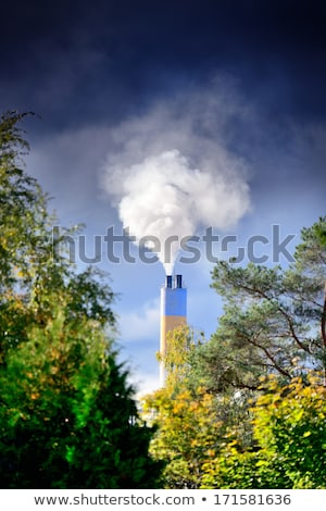 Factory chimney and trees. Stock photo © d13