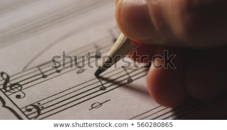 Close-up of a musical note book and a piano Stock photo © bmonteny