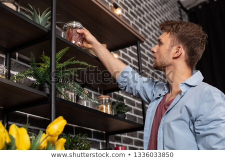 Young handsome man in kitchen Stock photo © jiri_miklo