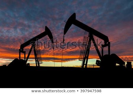 ストックフォト: 2 · 油 · シルエット · 作業 · 太陽 · 空