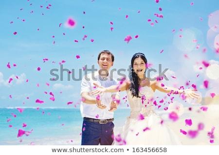 weddingcouple with shower of rose petals stock photo © ainat