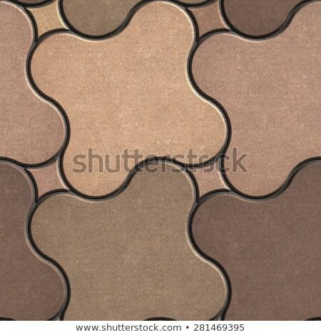 Beige-Brown Paving Stone as Quatrefoil. Stock photo © tashatuvango