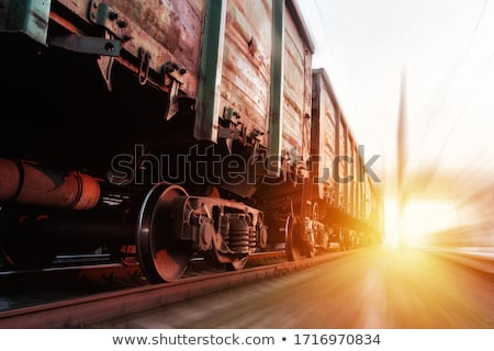 Freight train passing by on sunset  Stock photo © papa1266