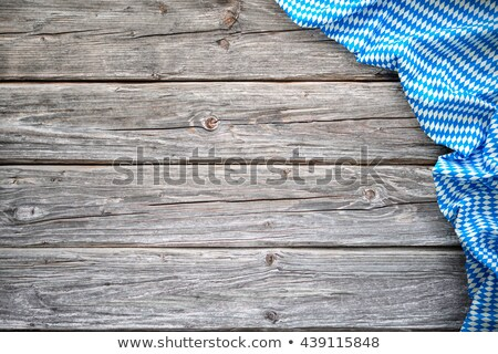 A wooden background with a bavarian table cloth Stock photo © Zerbor