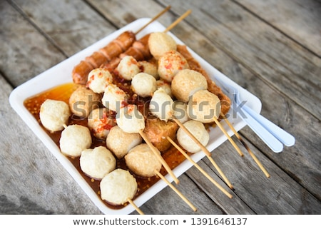 Squid ball and hotdog grilled on wooden plate Stock photo © nalinratphi