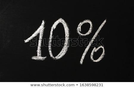 Hand drawing ten percent on blackboard  Stock photo © deandrobot