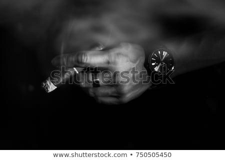 Człowiek palenia ciemne strony twarz świetle Zdjęcia stock © zurijeta