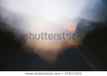 złoty · słońce · chmury · wir · horyzoncie · streszczenie - zdjęcia stock © frankljr