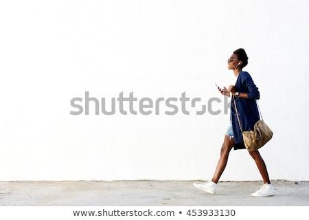 Nő sétál stúdiófelvétel vonzó nő kék ruha Stock fotó © filipw