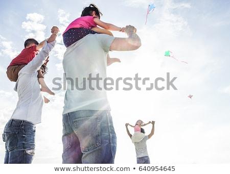 Erkek oynama omzunda sıcak okyanus Stok fotoğraf © meinzahn