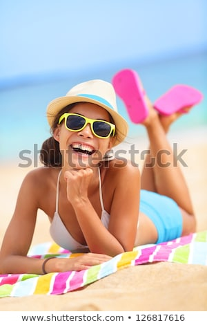 portrait of a laughing woman wearing beach hat and bikini stock photo © deandrobot