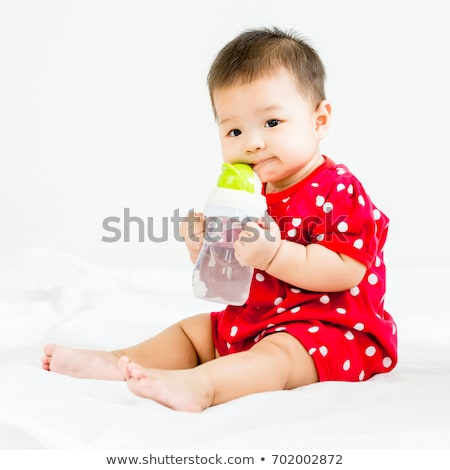 Baby Sitting on the Floor with a Bottle. Stock photo © robuart