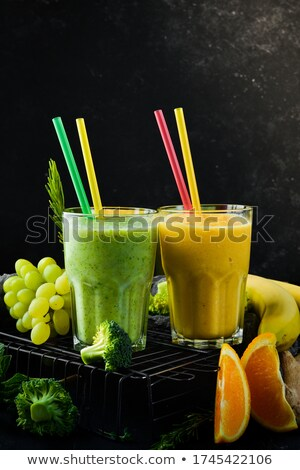 Spinach smoothie on a wooden background Stock photo © Yatsenko