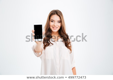 Young cheerful woman showing phone display to camera. Stock photo © deandrobot