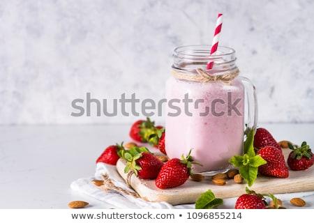 Strawberry smoothie or milkshake in jar on natural background, h Stock photo © Yatsenko
