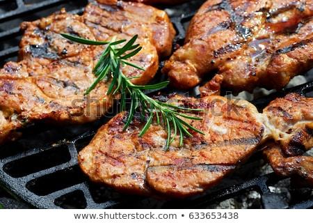 Mariné porc steak légumes garnir blanche Photo stock © Digifoodstock