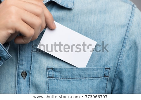 vertical image of man showing empty pockets stock photo © deandrobot