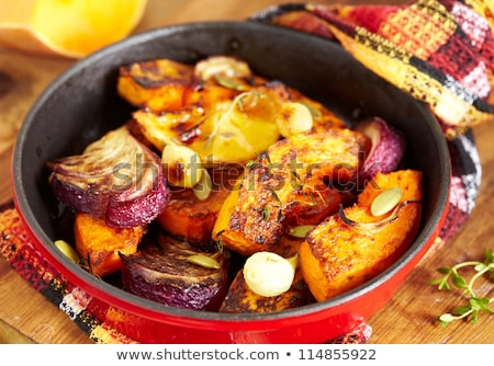 roasted pumpkin and onion, vegetable garnish Stock photo © yelenayemchuk