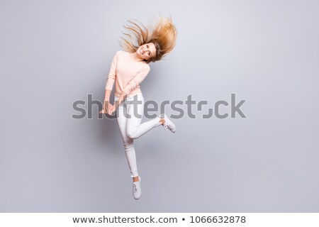 portret · gelukkig · blonde · vrouw · zwarte · springen - stockfoto © deandrobot