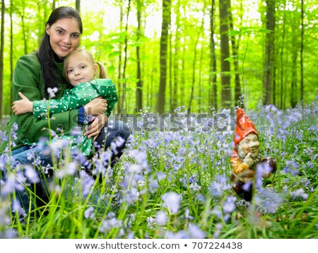 mother and daughter next to garden gnome stock photo © is2