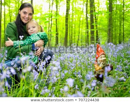 nina · flor · mano · hierba - foto stock © is2